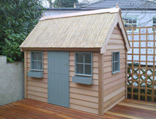 Cedar cottage with reed roof