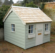 Painted Cottage with shiplap cladding and cedar roof